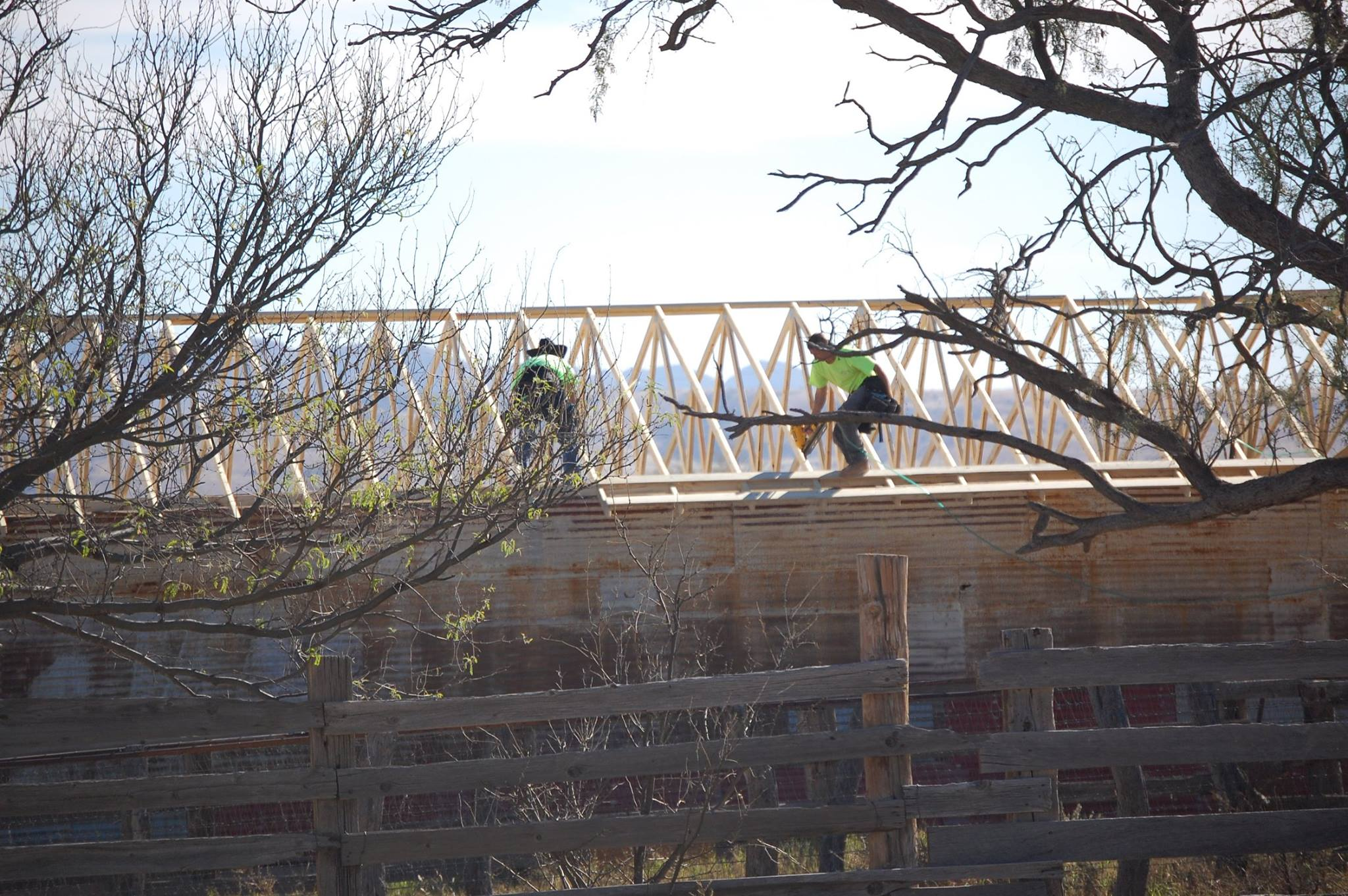 Feed barn, trusses go up, BY